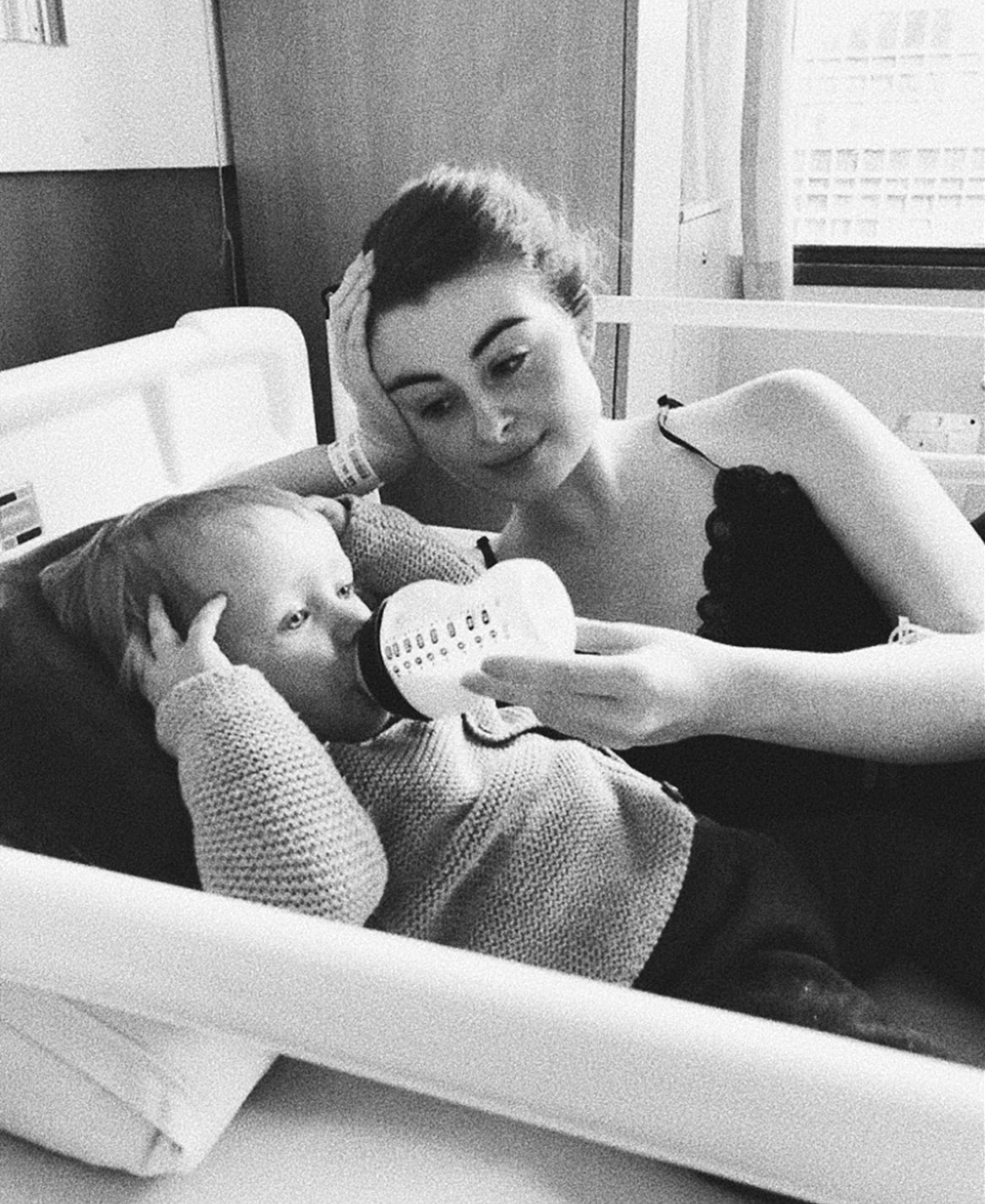 black and white photograph of mother and baby