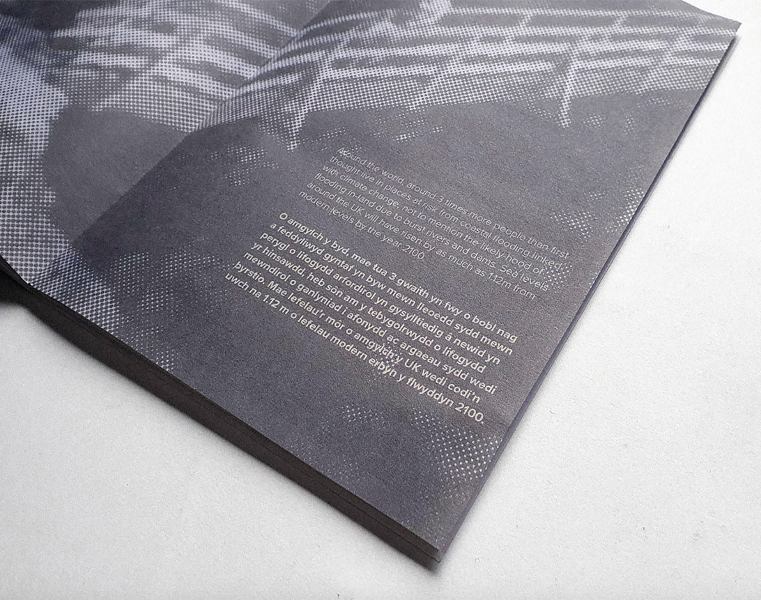 photograph of publication spread featuring type and half-toned photograph
