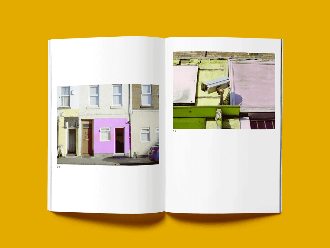 mock-up of publication spread featuring photographs of Liverpool